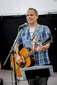 Playing at a local festival  (image by kind permission of Photashoot.com)
